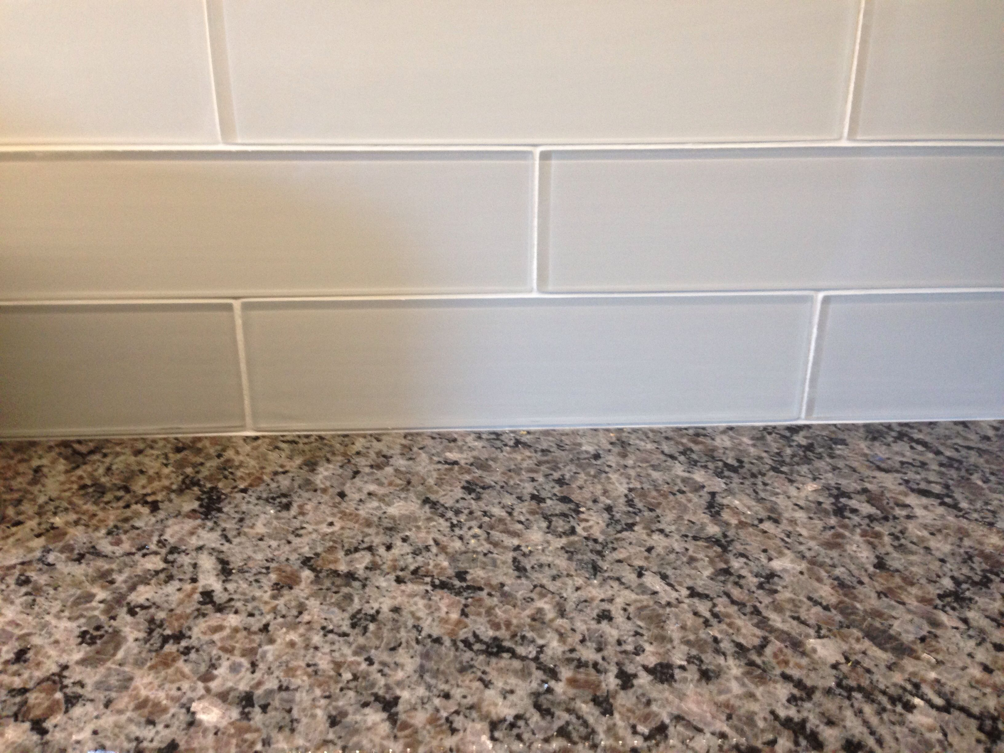 Kitchen Tiles Granite New Caledonia Granite Countertops And White Glass Tile