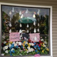 April shower bring May flower window display at Silks and ...