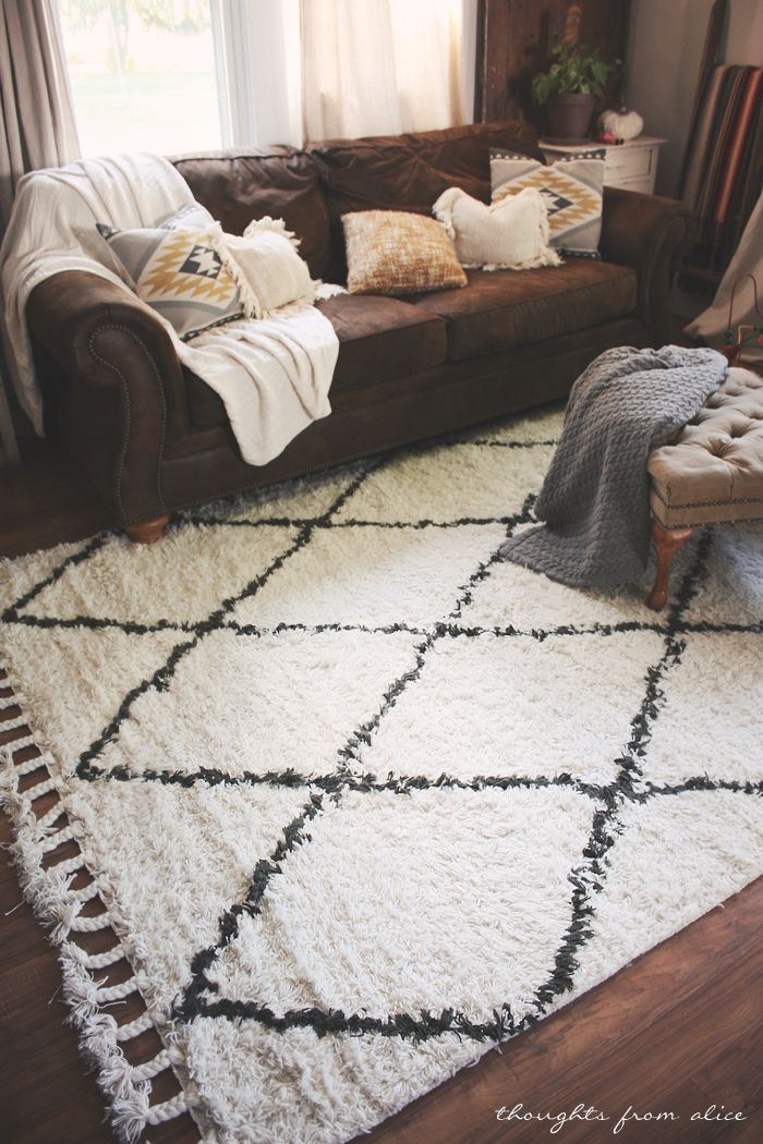 Boho Chic Living Room Makeover Finding the Perfect Rug Chic - brown rugs for living room