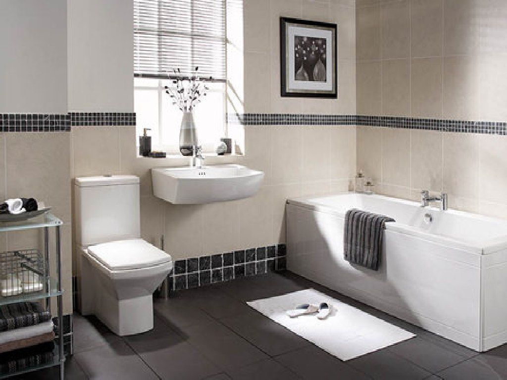 Wonderful black and white bathroom design with excellent dark grey floor tile for dashing white appliances