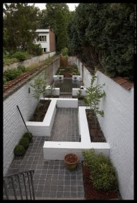long narrow garden with different points of interest ...
