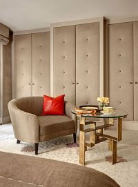 Master bedroom padded fabric buttoned wardrobe doors ...