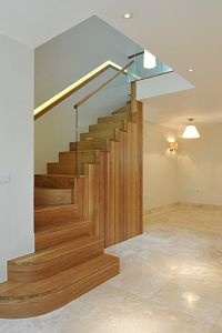 Oak staircase with timber through the glass and a ...