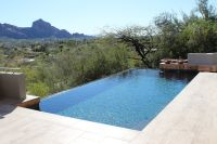 Contemporary pool deck with a view featuring Espresso Vein ...