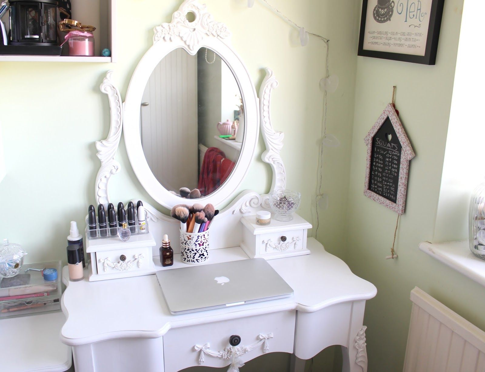 Attractive white oval mirror and unique white makeup dressing tables as antique vanities in women bedroom