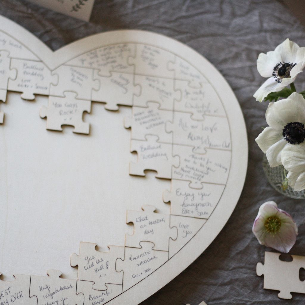 wedding photo books Wooden heart jigsaw puzzle wedding guest book available to buy from theweddingomd