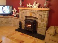 Nestor Martin stove stone fireplace
