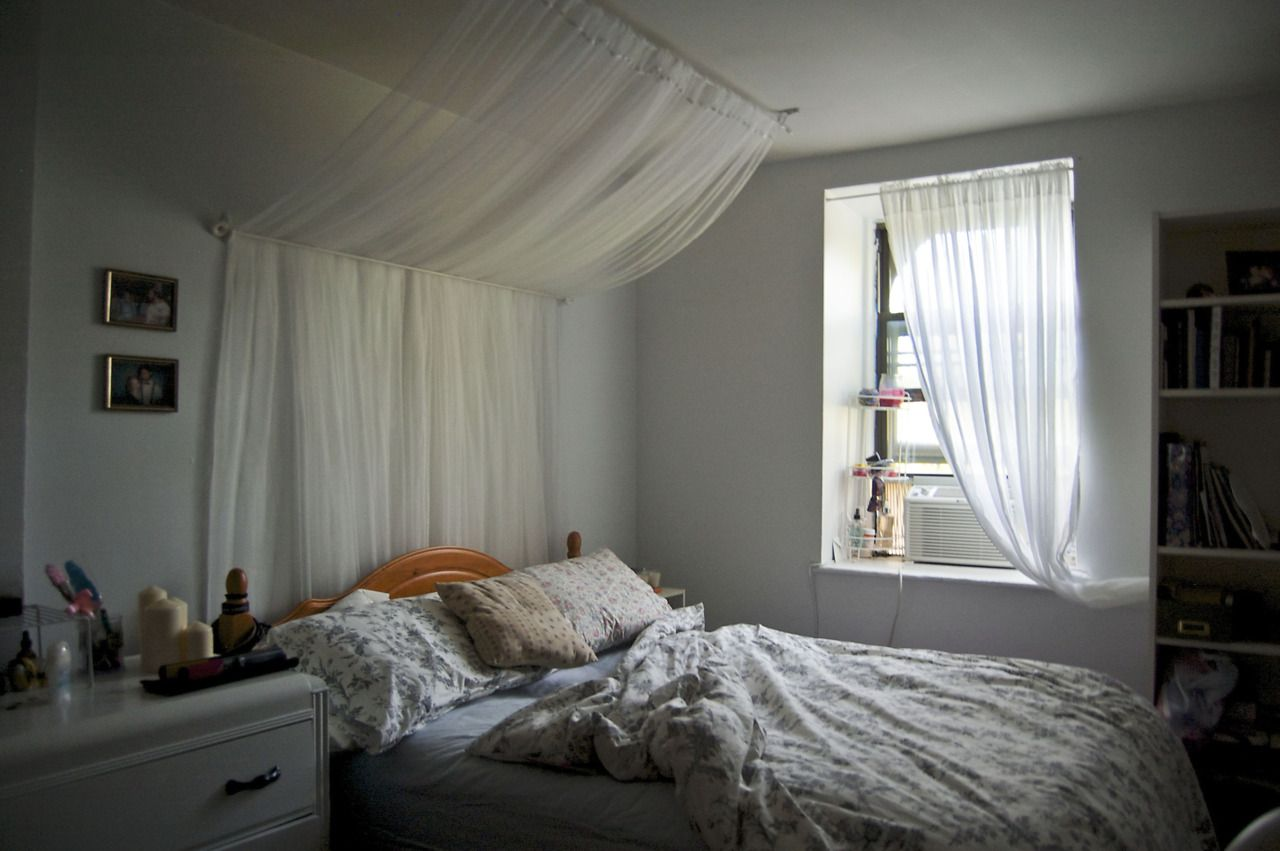 Curtains On Wall Behind Bed White Bedroom In Brooklyn New York Canopy Over The Bed Is