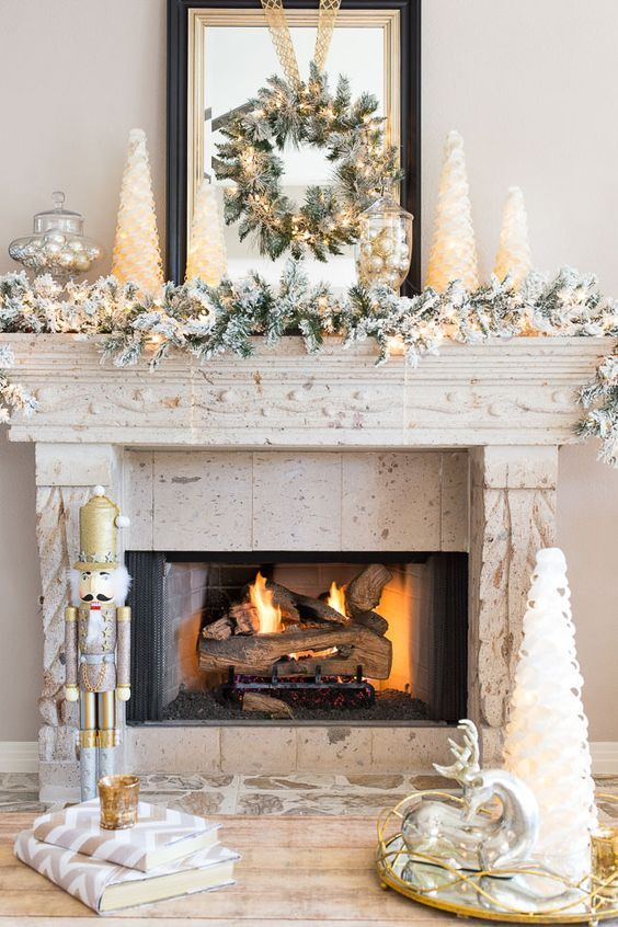 02 a faux snowy garland and wreath with lights - Shelterness - christmas mantel decor