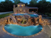 Two level luxury pool with waterfalls, slide, swim up bar ...