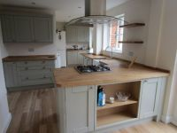 Nice colour cabinets- wood worktop with wooden flooring ...