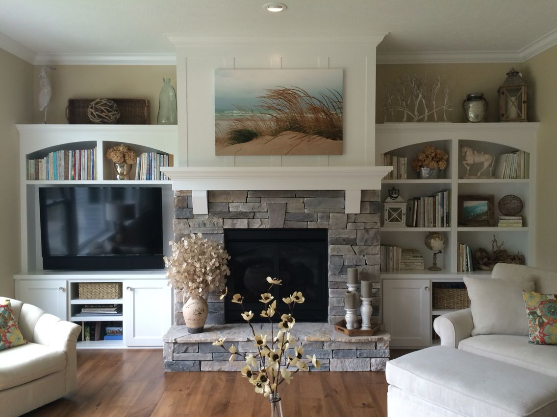 Gas fireplace with stacked stone, pieced hearth, corbels