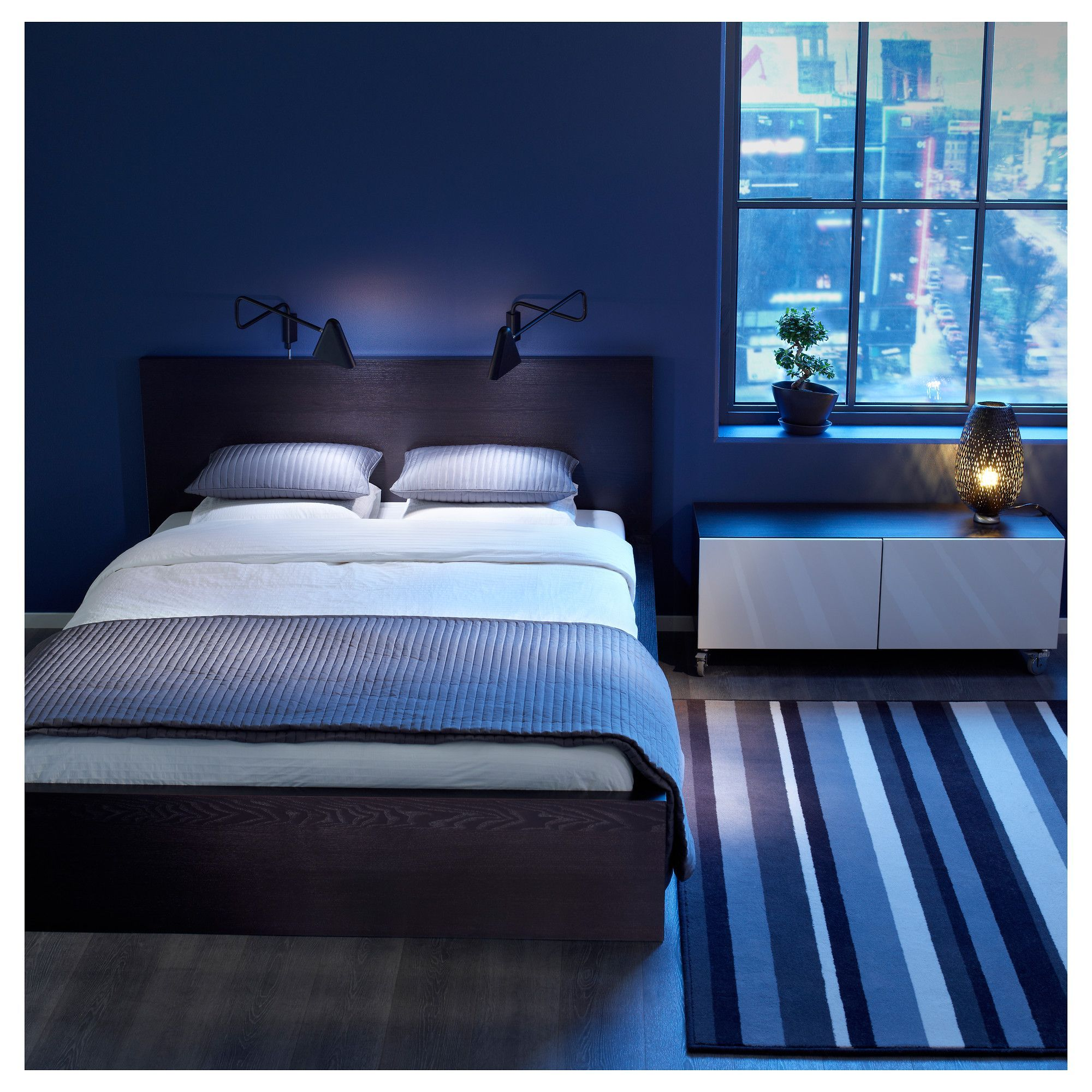 Best blue themed bedroom decorations with dark wooden platform bed plus white bedding plus brown wooden headbaord plus white cushions and striped carpet