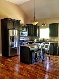 dark wood kitchen cabinets with dark wood floors ...