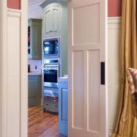 Kitchen Photos Swinging Door - between the dining room and ...