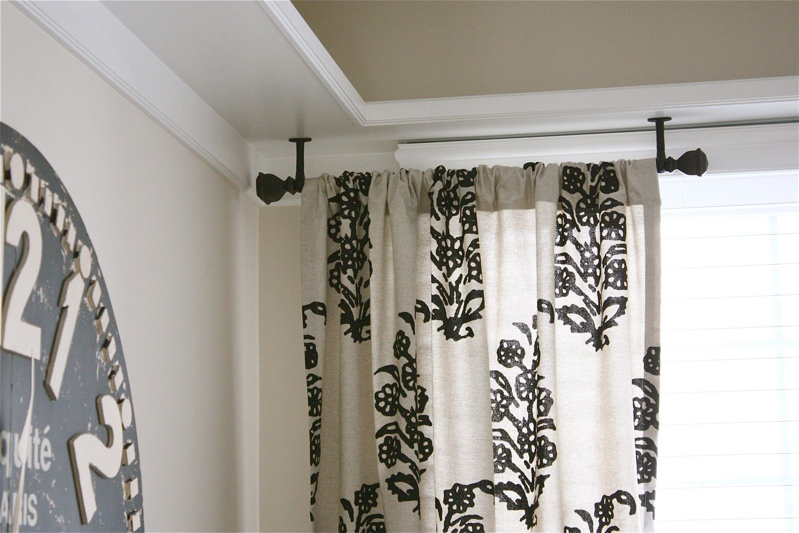 Hanging curtains partial rods and visual flow effective partial black ceiling rod
