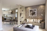 Break up a large room with furniture to create different ...