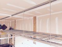 Garage storage rack above garage door made from unit strut ...