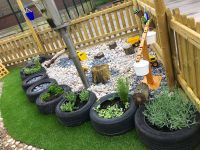 Outdoor Learning EYFS. Tyre planting, pebble digging pit