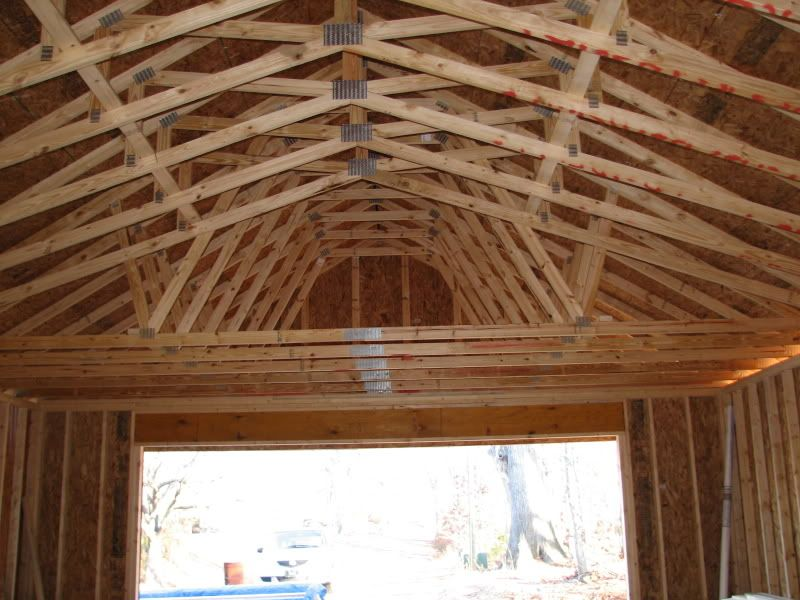 2 Car Garage With Scissor Truss Roof. Lots Of Interior Height, But