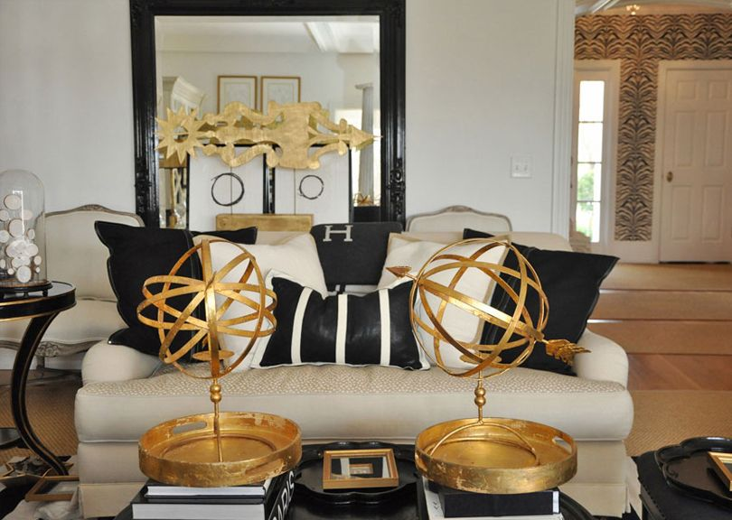 Black, white and gold! Note the zebra wallpaper in the background - black white and gold living room ideas