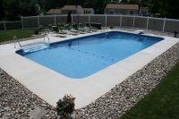 Rectangle style pool with brushed concrete decking. http ...