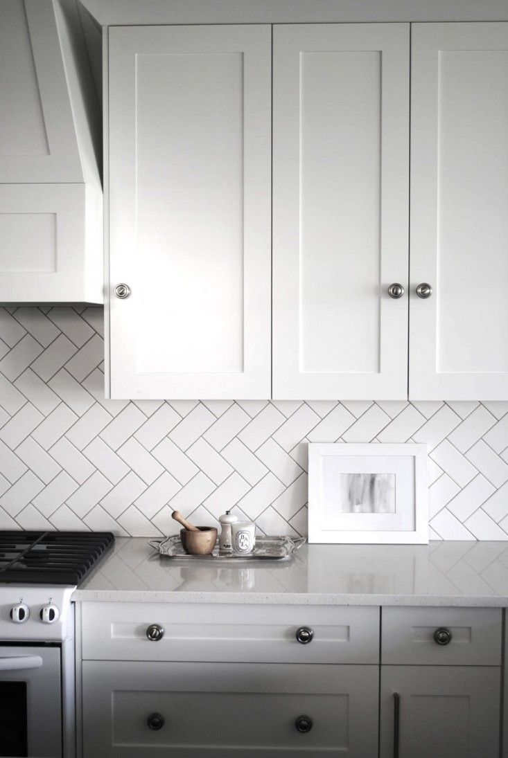 Subway tiles take on a fresh look when they re laid in a herringbone pattern