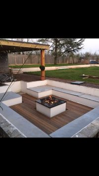 Sunken seating area with fire pit | Stunning Pools With ...