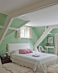 Mint green walls work so well in this traditional bedroom ...