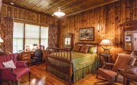 Rustic log cabin bedroom pine wood walls neutral interior ...