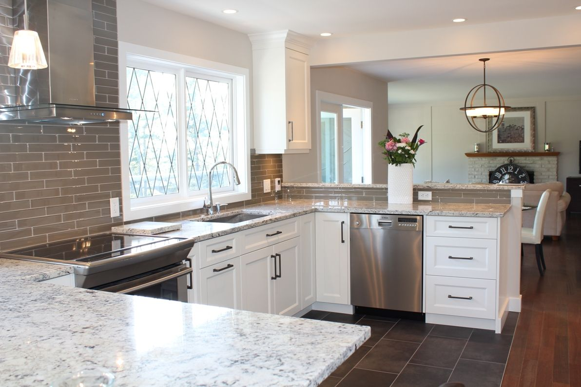 Snow white quartz countertop on painted white cabinets north vancouver kitchen renovation
