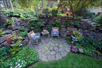 Grotto garden with deck in back ground: Galium odoratum at