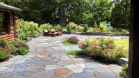 Patio and stone wall by Steven Breed Garden designs using ...