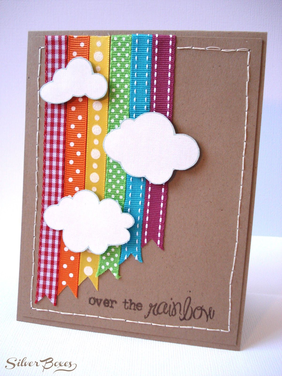 Like the varying lengths of notched ribbon good background idea on scrapbook page to use up old ribbon