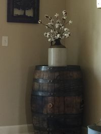 Jack Daniels whiskey barrel, old jug and cotton stems ...