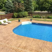 Stamped and colored concrete pool deck with custom ...