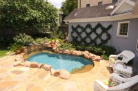 Backyard with flagstone deck and professionally installed ...