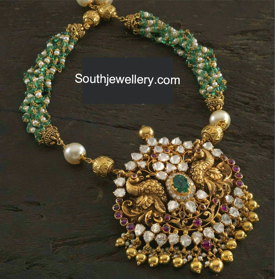22 carat gold beads necklace with multiple twisted chains of pearl and emerald beads attached