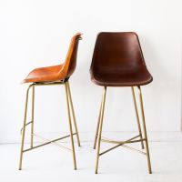 A saloon-style bar stool made of hand whip stitched ...