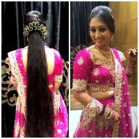 Traditional Southern Indian bride wearing bridal lehenga ...