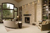 Contemporary living room with stacked stone accent wall ...