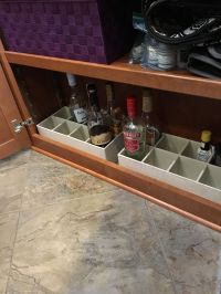 Liquor bottle storage in a fifth wheel bottom shelf. great ...