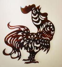 This Artsy Rooster Metal Wall Art is crowing to find a