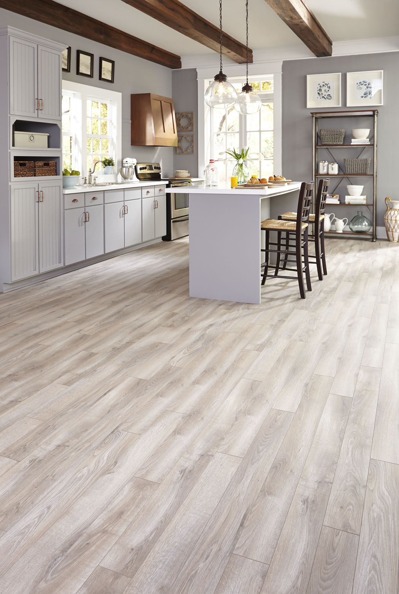 laminate flooring in kitchen Top Style Gray is a top trend we love and this gorgeous laminate floor is a favorite among customers This neutral look complements your home without