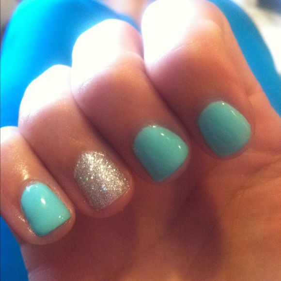 Turquoise Nails With Glitter Make Up And Nail Polish
