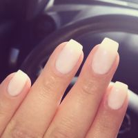 Short coffin shaped gel nails .. color is opi funny bunny ...