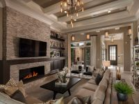A dramatic coffered ceiling defines this great room that ...