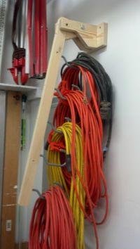 Extension Cord holder - Part 1. Uses bike hooks screwed ...