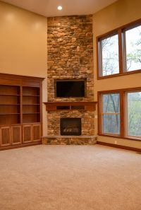 Floor to ceiling corner stone fireplace | Fireplaces ...