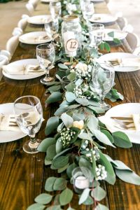 Long Feasting Table with Garland Greenery Centerpieces and ...